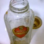 cleaning old preserves jar bottle