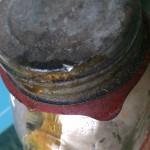 leaking lid on vintage preserves bottle