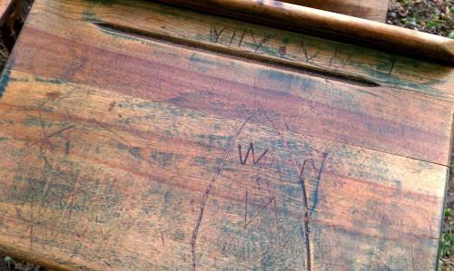 names carved into antique wooden school desk
