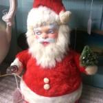 kitschy rubber-faced masked stuffed santa bottle brush tree light