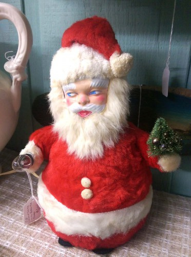 kitschy rubber-faced masked stuffed santa bottle brush tree light