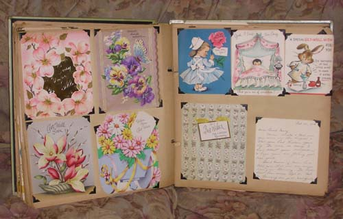 vintage greeting cards in old scrapbook